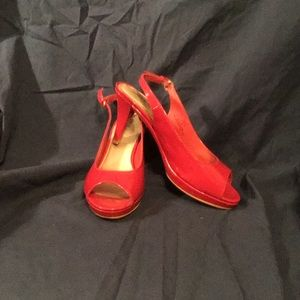 Red open toed pumps